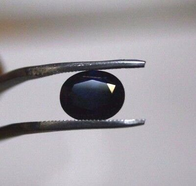 Natural Australian earth-mined blue/black oval sapphire gem..2.2  carat