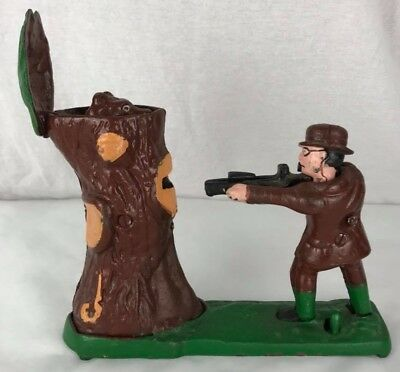 Vintage Cast iron metal figural hunter with bear coin penny Bank Taiwan