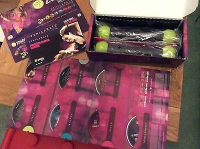 Zumba Fitness Exhilarate Body Shaping System - 7 DVD Set With Toning Sticks [CH]