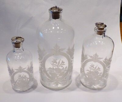 3 Graduated Stoppered Bottles, Acid Etched Florals, Decanters, Dresser Set.
