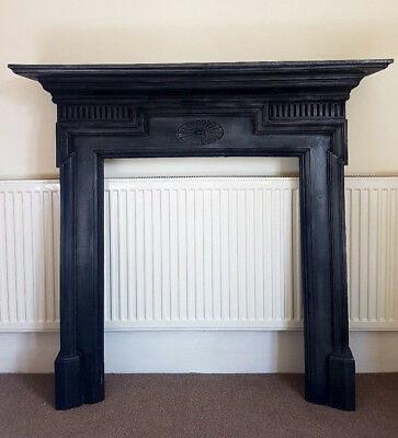 Large cast iron fireplace mantel surround with beautiful details