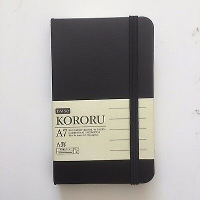 A7 Pocket Notebook Small Black Faux Leather Bound with Black Elastic Wrap Around