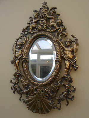 Vintage French ornate brass wall mirror, oval bevelled glass, cherubs, ribbons