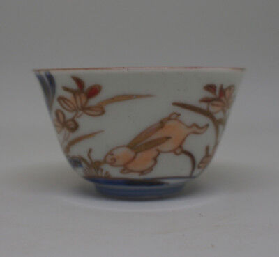 Beautiful enamelled gilt porcelain saki cup decorated with gambling rabbets 19C