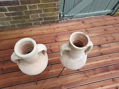 A pair of Victorian clay garden urns on metal stands