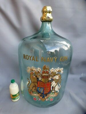 A Huge Royal Naval Gin Demijohn With Royal Coat Of Arms And Brass Stopper