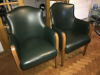 A Pair Of Green leather Tub Chairs - no reserve