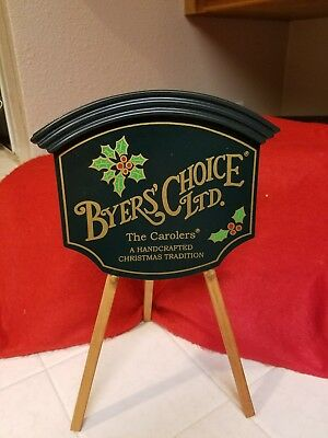 BYERS' CHOICE LTD THE CAROLERS SIGN wirh stand.