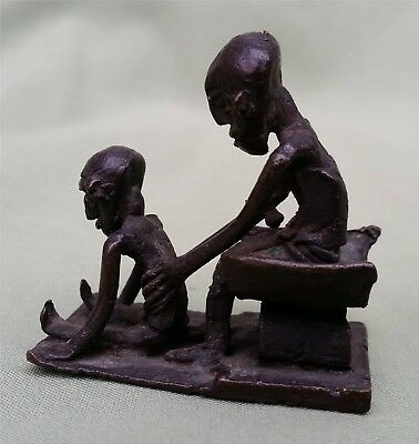 Early African Ashanti Goldweight.   Very early patina. Man & Child on Stall