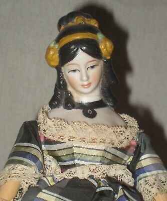 Bisque head-wooden jointed body- Shackman Doll- Black hair- dressed