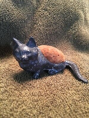 Antique metal cat pincushion