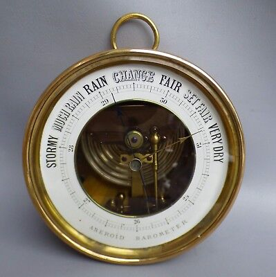 A Good Quality Brass Cased Open Face Aneroid Wall Barometer With D.c Anchor Mark