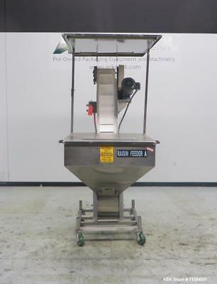 Used- Incline Belt Conveyor With Stainless Steel Feed Hopper. Unit has hopper di