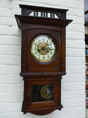 Antique wall clock. brown wood medium size. from around 1900/1920