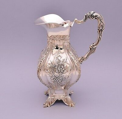Beautiful Solid Silver Repousse Pitcher.