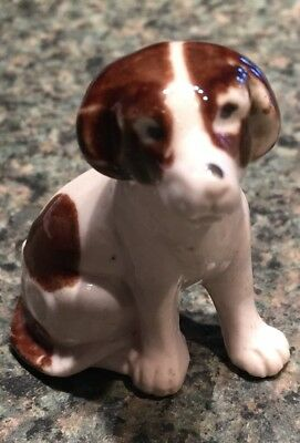 Vintage Porcelain figurine of a brown and white English Springer Spaniel puppy