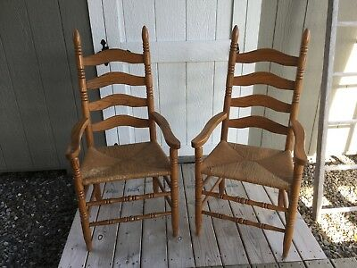 Set Of Two Solid Oak Ladder Back Arm Captain Chairs With Rush Seats