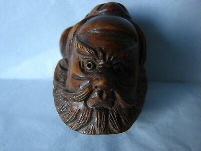 Netsuke 2 faced, a man, upside down a monkey?