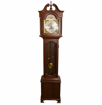 Daneker Grandfather clock. Mahogany-finished case with brass tone
