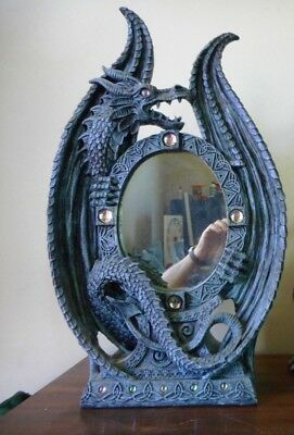 Dragon statue with mirror about 40cm high and 30cm wide