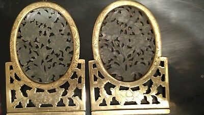 Jade table screens, mounted in engraved brass, modified for hanging on wall.