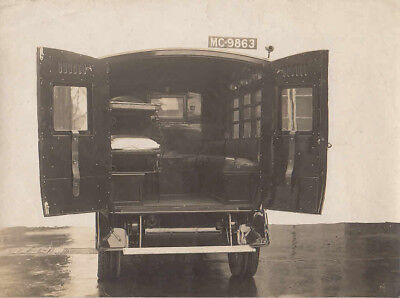 Ambulance With Rear Doors Open, Photograph.