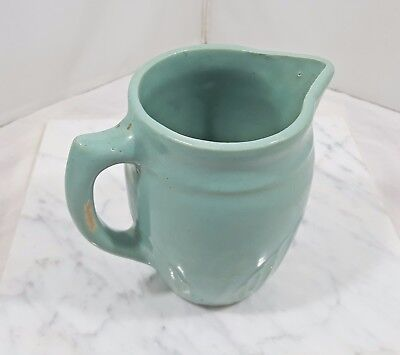 "Vintage Unmarked Matte Green Pottery 6"" Milk / Cream Pitcher with Shell Design"