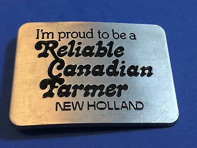 NEW Holland Tractors  Proud to be reliable Canadian farmer belt buckle  1982