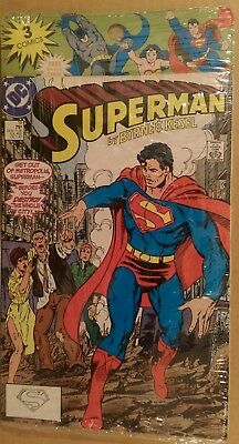 Superman copper age of 3 comic books and trading cards in a sealed bag
