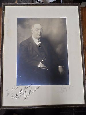 autographed framed photo with unknown signature