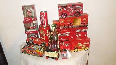 Large lot of collectible Coca Cola tins, and memorabilia, take a look