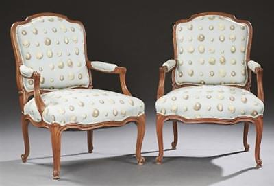 Pair of French Louis XV Style Carved Walnut Fauteuils, early 20th c.,... Lot 644