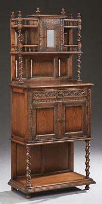 Henri II Style Carved Oak Server, late 20th c., the spindled crown ov... Lot 630