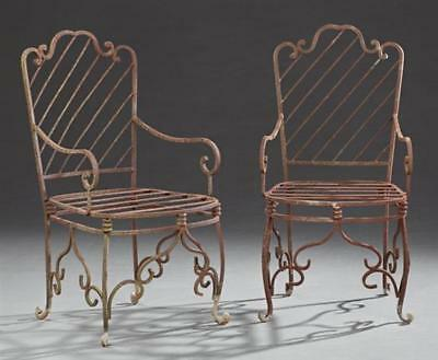 Pair of Wrought Iron Patio Armchairs, late 20th c., the scrolled back... Lot 917