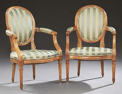 Pair of French Louis XVI Style Carved Cherry Fauteuils, 19th c., the ... Lot 973
