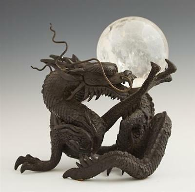 Chinese Bronze Dragon, early 20th c., holding a rock crystal ball, H.... Lot 836