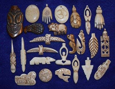 25  different hand carved bone beads/pendants artistic objects
