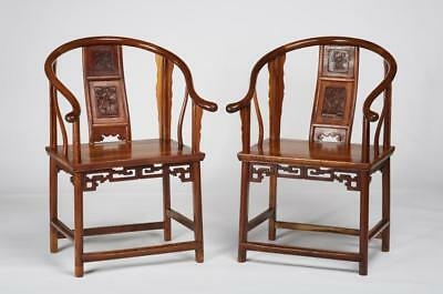 Pair of Antique Carved Chinese Elm Horseshoe Armchairs Lot 52