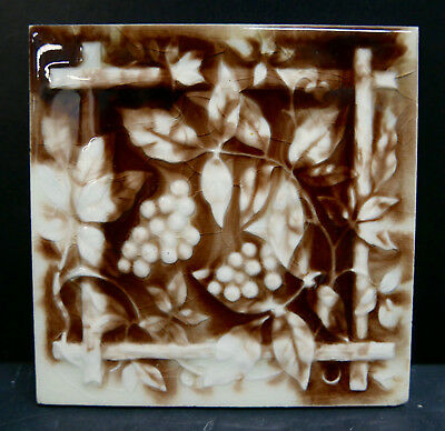 Providential Antique Tile with Vine