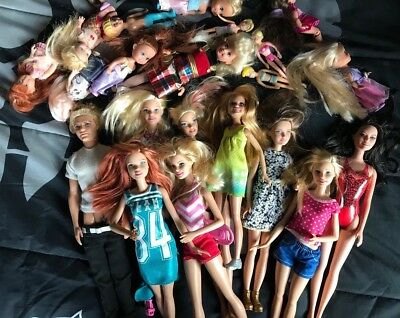 large lot of barbie dolls and clothes