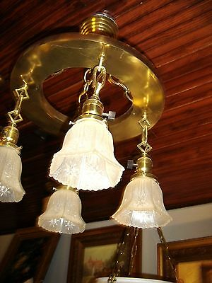 Antique 4-Light Brass Fixture with 4 Matching Pressed Glass Shades.8200