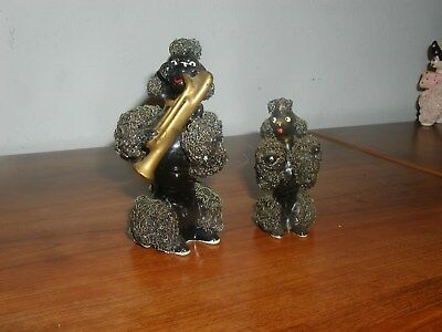 Two Black Spaghetti Poodles One Playing A Horn - Look Great