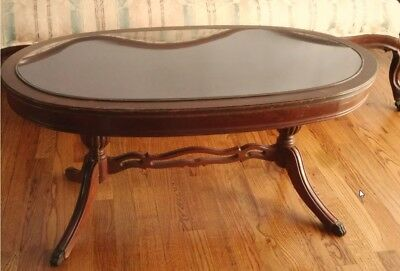 Glass top oval table brass claw feet