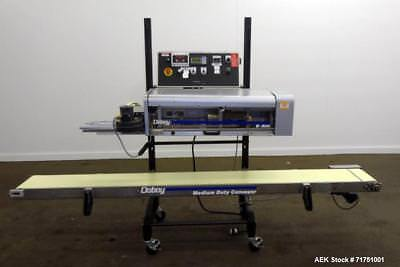 Used- Doboy Model B500 Band Sealer with Integrated Conveyor and Trimmer. Bag sea