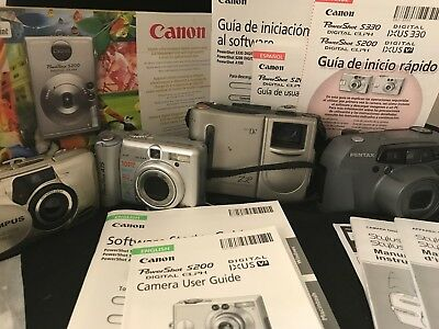 LOT 11 PC OLYMPUS CANON DV Power Shot PENTAX Cameras Guides Discs Untested