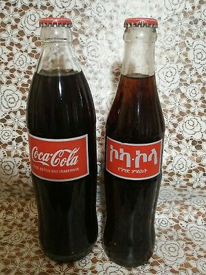 2 Ethiopian Coca- Cola bottles. 500 AND 300 ML.ONLY SHIPPING IN USA