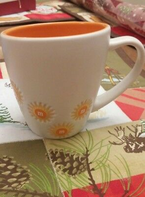 M&M's Asymmetrical Sunburst Ceramic Coffee Cup Orange m&m's world