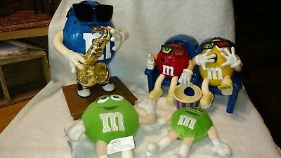 M&M's Lot Of 4- Saxaphone & 3-D Movie Theater Dispensers & 2 Plush Green Girls