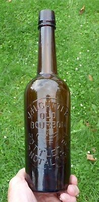 """ J.H. CUTTER/OLD/BOURBON/BOTTLED BY/A.P. HOTALING "" Amber Bimal Whiskey Bottle"