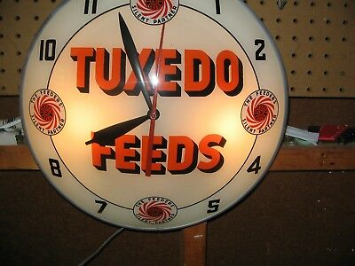 1950's Tuxedo Feeds Double Bubble Clock